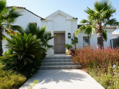 Photo for Beautiful villa in Ibiza style with 4 bedrooms, swimming pool and lush garden