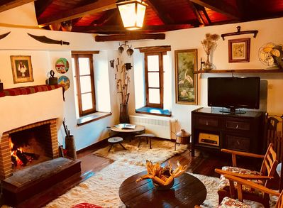 Cozy upstairs sitting room (original hearth) with fireplace sleeps two.