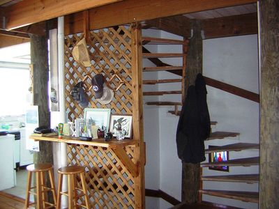 Spiral staircase with kitchen on the left
