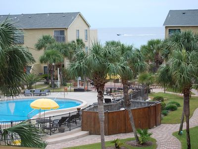 Photo for Steps to beach, pool, & hot tub - Couples & Family Getaway