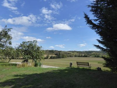 The bottom of our garden and view to the fields and hills beyond