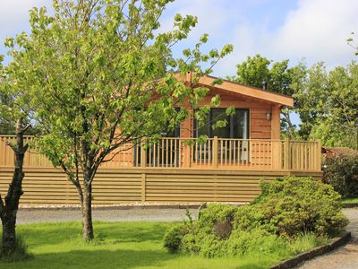 Photo for Cherry Tree Lodge with wood-burning hot tub in private garden close to beach