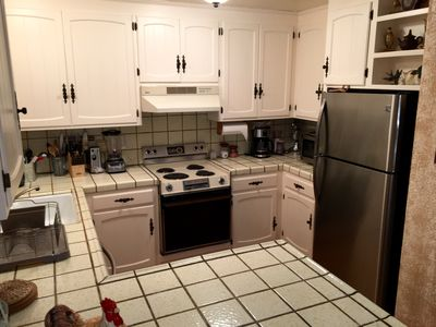 Spacious kitchen includes refrigerator, dishwasher, oven/stove top and microwave