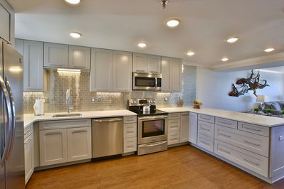 The kitchen is fully stocked with dishes, utensils, appliances, cooking supplies