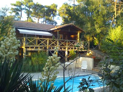 Photo for charming villa, facing south, with pool located on the top of a dune in the pines