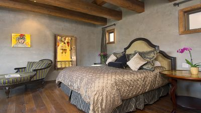 Master Suite with King Bed & en suite bathroom with luxurious soaking tub.
