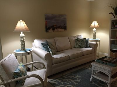 Read or watch TV in comfort. canvas is photo of St. John's Pier at sunset.