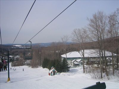 View of unit and pool (behind evergreens) from Morse Chairlift