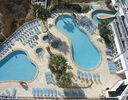 OVERHEAD VIEW OF TWO POOLS & HOT TUBS BY THE SOUTH TOWER @ SEA WATCH