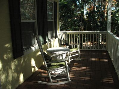 Rocking chairs on front porch.