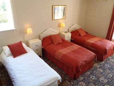 The Twin Room made up with three single beds