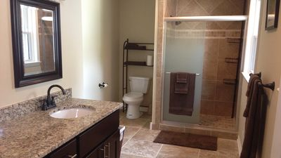 Huge master bath has a shower, double vanity and a HUGE walk in closet!