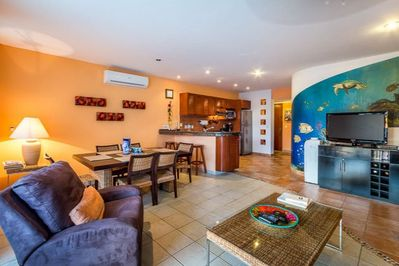 Large common area with entertainment center with flat-screen TV, WiFi, DVD player, and collection of movies
