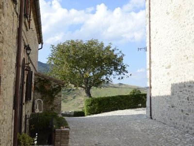Photo for Charming apartment in a medieval village with beautiful garden and wifi