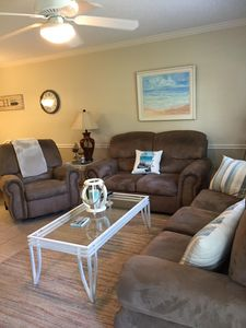 Living room with sofa, recliner and love seat