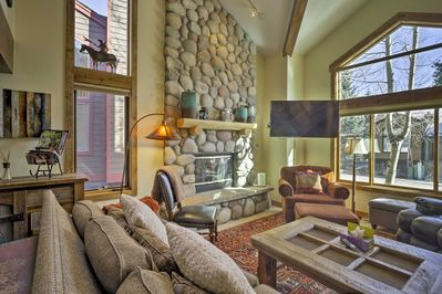 Cozy up next to the beautiful 2-story stone gas fireplace.