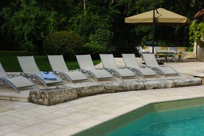 adjustable chaises longues poolside