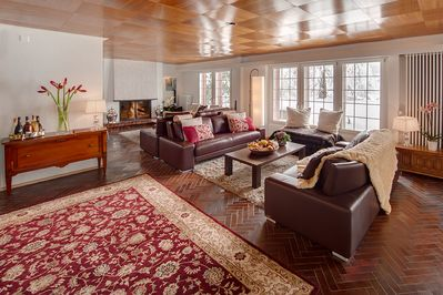 The spacious lounge comfortably accommodates 12 guests.