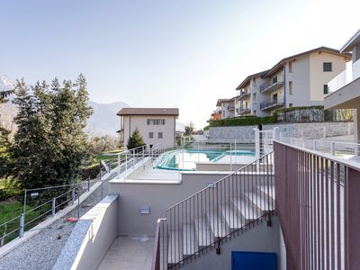 Photo for Modern apartment overlooking the lake/mountains w/ shared pool!
