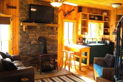 cozy cabin inside, with full kitchen and TV