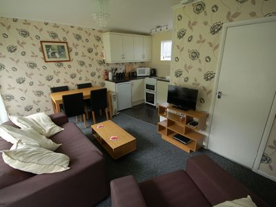 Photo for Chalet with open planned kitchen/living area, benefiting from direct access to fantastic cliff walks