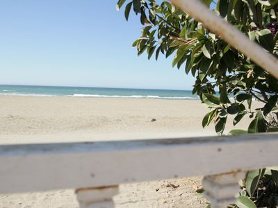 Photo for Low with direct access to the beach and with a patio of 75m2