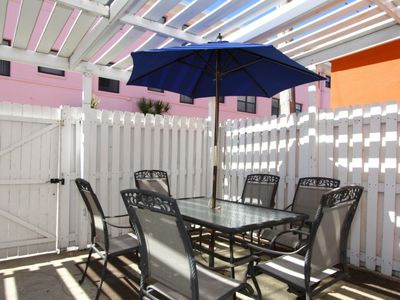 Photo for Special Extra Large Outdoor Patio Area. Easy Walk to Great Beaches, Shopping, and Restaurants.