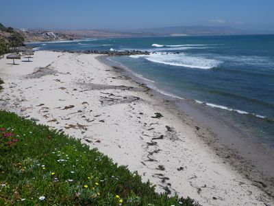 The Las Gaviotas private beach has sand, surf,  volleyball court & fire pits.