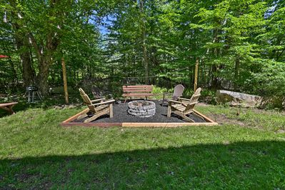 The 3-bedroom, 2-bath vacation rental house has it's own fire pit!