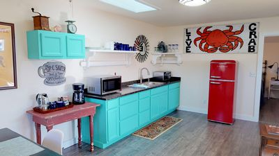 Colorful kitchenette includes microwave, toaster oven & fridge. - Colorful kitchenette includes microwave, toaster oven & fridge.