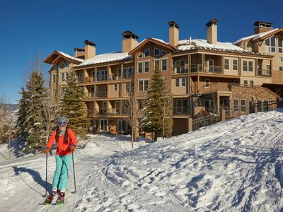 Photo for Ultimate luxury in ski-in/ski-out condo with shared hot tub/pool