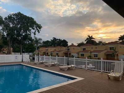 Photo for Palm Breeze Cottage -GATED COMMUNITY, Pool, Beach Access, HipStrip, NEAR AIRPORT