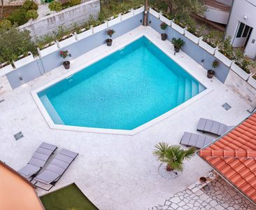 Photo for Holiday apartment with pool 250 m from the beach