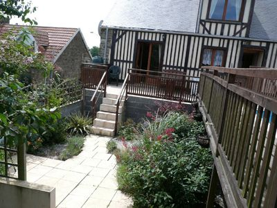 Chalet courtyard garden leading to terrace