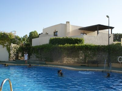 Photo for Villa with pool in gated community near the beach and town