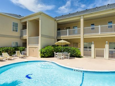 Photo for Courtyard condo with pool only 1/4 block to beach!