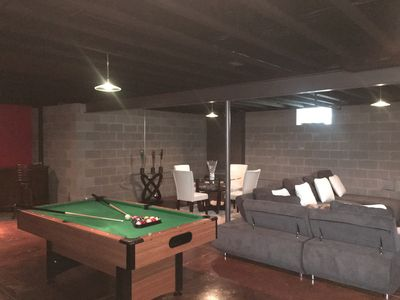 full basement with pool, table tennis, and sitting area.