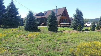 Enjoy the cool air on the deck of the Blue Spruce Chalet