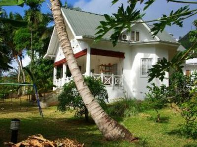 Photo for Anse Royale: Creole Style House with Beautiful garden overlooking a Private Beach