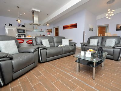 Spacious lounge with underfloor heating throughout