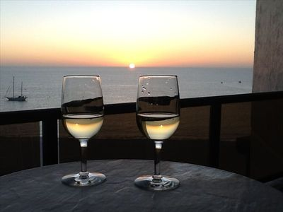 Relax and enjoy your private sunset from the lanai with a glass of wine