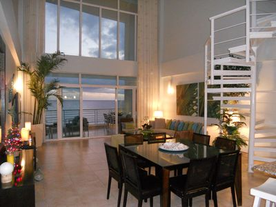 Stunnng great room with sliders to terrace and panoramic views of beach & ocean.