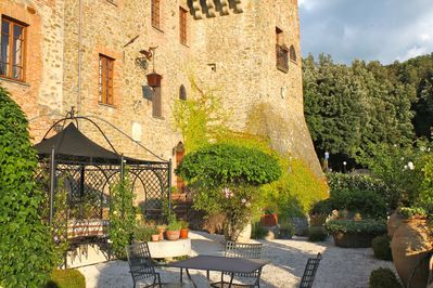 Our garden and the medieval tower of Paciano overlooking it,