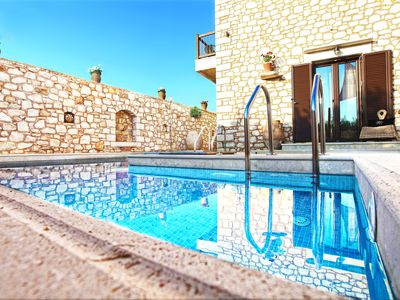 Photo for New stone villa with pool and jacuzzi near the sea surrounded by olive groves