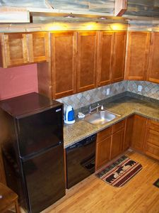 Small appliances: toaster, coffeepot, waffle maker, kettle. Lot of counter space