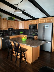 Open kitchen with upgraded appliances including a dishwasher.