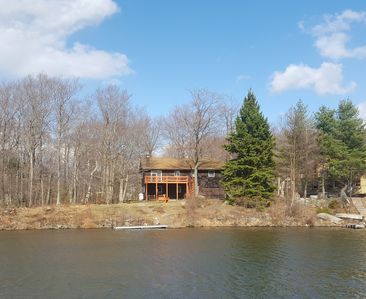 View of the back of the house from the other side of the lake.