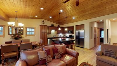The living area of this Truckee vacation home, complete with ample seating and a view of the kitchen.