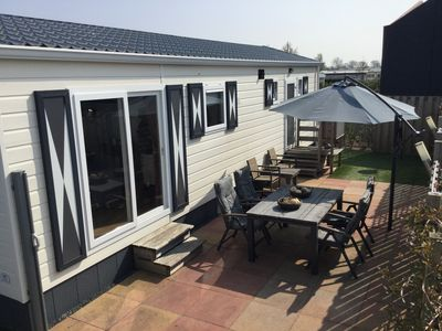 Photo for Complete and luxurious 6 person chalet at a holiday park on the coast with free WiFi