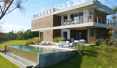 Photo for *Modern beach house with stunning ocean views and 11 m heated  infinity pool**